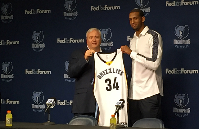 Grizzlies general manager Chris Wallace presenting Brandan Wright with his new jersey.